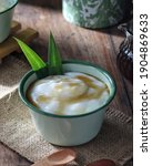 Small photo of Bubur or jenang sum sum, indonesian sweet coconut rice porridge. Bubur sum sum is an Indonesian dessert made by cooking rice flour in coconut milk and served with palm sugar syrup. Selective Focus