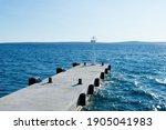 Empty Concrete Pier With White...