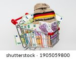 Shopping Cart With Bundles Of...