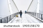 During A Snowstrom  A Woman...