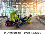 Small photo of First aid support accident in site work, Builder accident fall scaffolding to the floor, Safety team help employee accident.