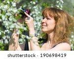 young woman photographs cherry... | Shutterstock . vector #190698419