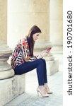 young brunette girl using a... | Shutterstock . vector #190701680
