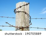 Barbed Wire Around A Wooden...