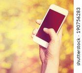 woman hand holding smartphone... | Shutterstock . vector #190756283