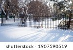 Metal Fence In The Snow In...
