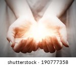 The Light In Young Woman Hands...