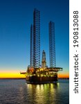 oil drilling rig in sunset time. | Shutterstock . vector #190813088