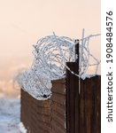 Rusty Fence With Barbed Wire. A ...