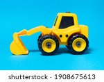 Toy Yellow Excavator On A Blue...