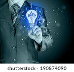 business man touching light of... | Shutterstock . vector #190874090