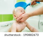 mom washing baby boy | Shutterstock . vector #190882673