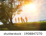 Small photo of Full length view of golfers on the golf course on sunny day