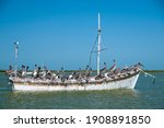 An Old Wooden Fishing Boat With ...