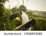 Small photo of pump pipe water flow equipment agriculture,Water from a well filled a pond for irrigation,Irrigation water from the source,Water flow from large pump tube in Farm,being flush out by a heavy tube