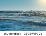 Surfer On The Crest Of A Wave ...