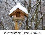 Snow Covered Wooden Bird Feeder ...