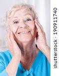 smiley elderly woman doing her... | Shutterstock . vector #190911740