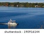 Pontoon Boat On A Blue Lake
