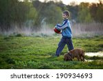 boy with a ball walking with a... | Shutterstock . vector #190934693