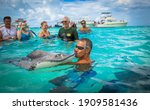 Small photo of Grand Cayman, Cayman Islands, Caribbean,11072019 The famous tourist attraction to meet wild stingrays in the unique shallow spot so called Stingray City
