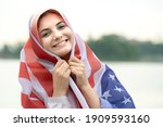 Young Happy Refugee Woman With...