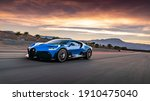 Small photo of California, USA - January 10, 2021: A blue Bugatti Divo W16 hypercar is driven on road in sunset