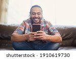 Smiling young latino man in his ...