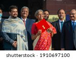 Small photo of New Delhi, India-1 February 2021Union Finance Minister Nirmala Sitharaman , MoS Finance Anurag Thakur with budget team shows iPad enveloped in red cover with a golden National emblem on it.