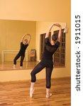 ballerina dancing in studio | Shutterstock . vector #1911015