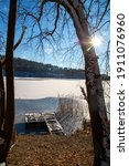 Small photo of Gangplank to the snowy lake, sunny day with blue sky
