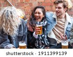 People Enjoying A Beer Together ...