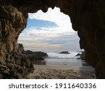 sandy floor sea cave at leo... | Shutterstock . vector #1911640336