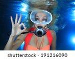 Happy Female Scuba Diver Show...