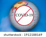 Small photo of Strikethrough inscription on the globe covid-19. The end of the coronavirus.