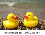Plastic Ducks At The Beach