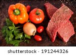 two raw steaks with vegetables... | Shutterstock . vector #191244326