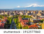 Small photo of Mount Ararat (Turkey) at 5,137 m viewed from Yerevan, Armenia. This snow-capped dormant compound volcano consists of two major volcanic cones described in the Bible as the resting place of Noah's Ark.