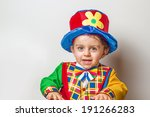 funny child wearing a clown suit | Shutterstock . vector #191266283