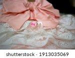 pink baby girl pacifier on... | Shutterstock . vector #1913035069