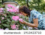 Woman With A Flower. Senior...