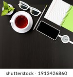 office desk with a cup of tea ... | Shutterstock . vector #1913426860