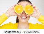 young brunette with orange in... | Shutterstock . vector #191380043