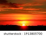 Sun At Sunrise With A Small...