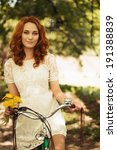 young red hair woman riding a...   Shutterstock . vector #191388839