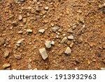 stones on wet yellow soil.... | Shutterstock . vector #1913932963