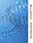 Small photo of two adjunctive helix in chrome on blue background
