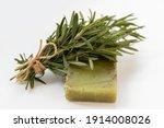 a piece of handmade green soap... | Shutterstock . vector #1914008026