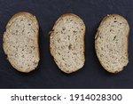three pieces of grain bread lie ... | Shutterstock . vector #1914028300