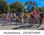 Small photo of La Rochelle, France - September 08, 2020: Blurred image of the peloton riding fast in front of the spectators in La Rochelle during the stage 10 of Le Tour de France 2020.